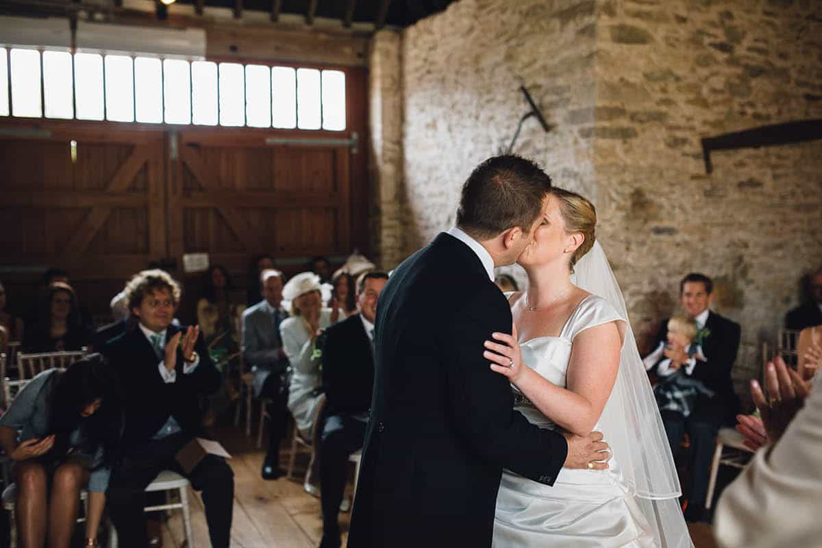 Kingston Country Courtyard Wedding Photographer - First kiss