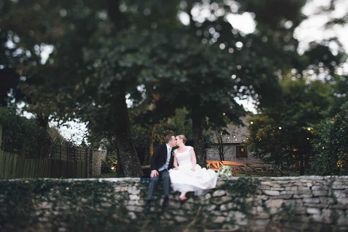 Kingston Country Courtyard Wedding Photographer - sat on the wall