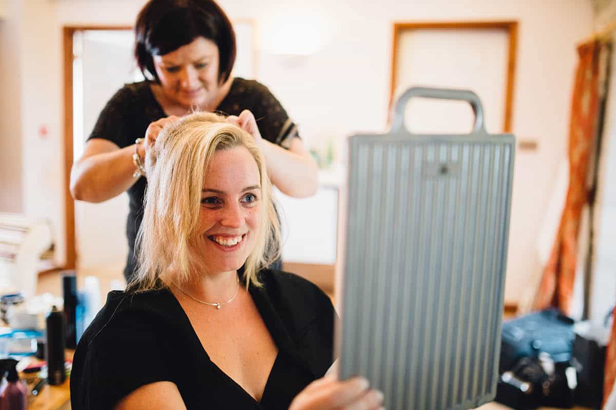 Kingston Country Courtyard Wedding Photographer - Brides hair being done