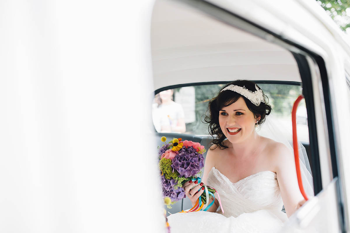 Festival Wedding Photographer - Bride arriving in a white taxi