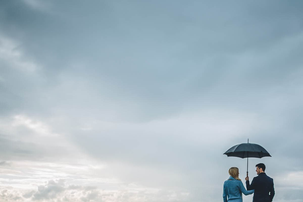 dorset engagement photography - rainy beach