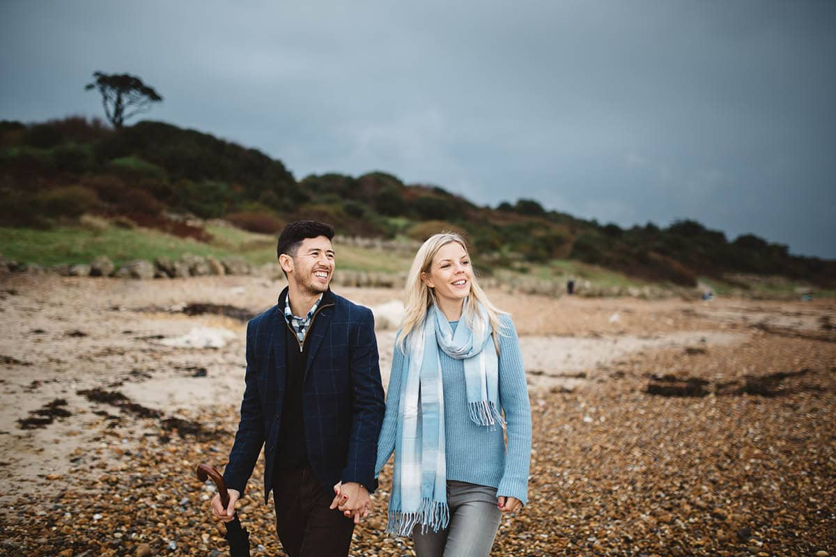 dorset engagement photography - taking a walk along the beach